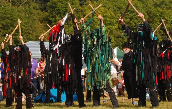 The Wild Hunt performing Thor's Hammer, a dance traditionally associated with thunder and light'ning! The team's Green Man, Graham Hyde, is flanked by dancers Lisa Williams and Dave Young (Picture courtesy of Colin Lowles).